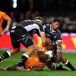 DURBAN, SOUTH AFRICA, 9,JULY, 2016 Raymond Rhule tackled by Garth April of the Cell C Sharks during The Cell C Sharks vs Toyota Cheetahs  Super Rugby Match at Growthpoint Kings Park in Durban, South Africa. (Photo by Steve Haag)<br /> <br /> images for social media must have consent from Steve Haag