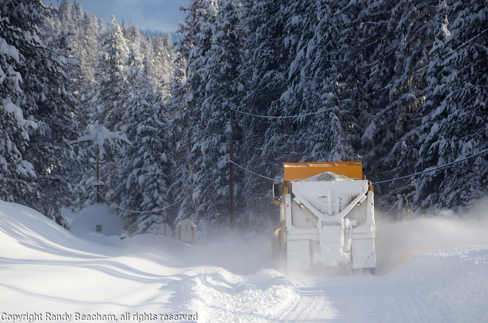 Lincoln County plow truck in the Yaak Valley during February 2017 winter snowstorm that dumped as much as three feet of snow on northwest Montana in three days. Yaak, Montana