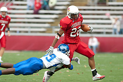 12 November 2005: Sycamore Jarret Harris goes horizontal to get a grop on Redbird Cortes Rice.  Illinois State Redbirds topple the Indiana State Sycamore 70-28 at Hancock Stadium in Normal Illinois