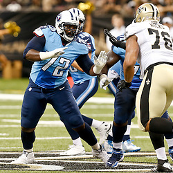Aug 15, 2014; New Orleans, LA, USA; Tennessee Titans offensive tackle Michael Oher (72) blocks New Orleans Saints defensive end Akiem Hicks (76) during first half of a preseason game against the New Orleans Saints at Mercedes-Benz Superdome. Mandatory Credit: Derick E. Hingle-USA TODAY Sports