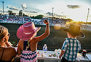 Eight-year-old Jaycee Lachnit pumps her fist while watching the bareback riding competition with mom Caitlyn, left, and brother Tayton (2), all of Alexandria, on Thursday night during the first night of the 45th annual Corn Palace Stampede Rodeo at Horseman Arena in Mitchell.(Matt Gade/Republic)