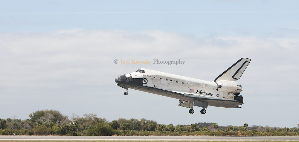 Space shuttle Discovery lands on runway 15 at the Shuttle Landing Facility at Kennedy Space Center in Florida on Wednesday, March 9, 2011.