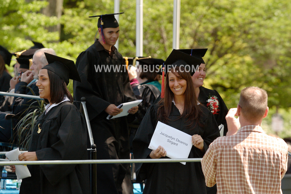 Middletown, NY - A graduate smiles for the camera after receiving her diploma during the 58th commencement at Orange County Community College on May 17, 2008.