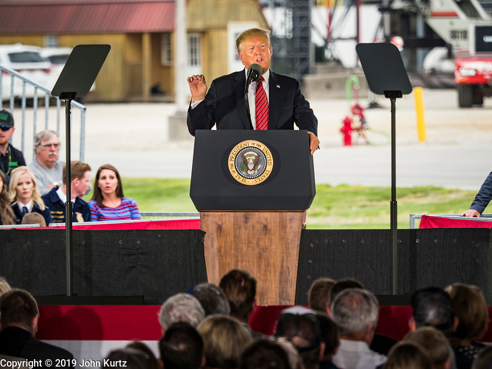 11 JUNE 2019 - COUNCIL BLUFFS, IOWA: US President DONALD J. TRUMP talks to Iowa and Nebraska farmers and biofuel industry representatives at Southwest Iowa Renewable Energy. President Trump visited Southwest Iowa Renewable Energy in Council Bluffs Tuesday to announce that his administration was relaxing rules on E15, an ethanol additive for gasoline. Iowa is one of the leading ethanol producers in the U.S. and Iowa corn farmers hope the administration's change in E15 rules will spur demand for corn.             PHOTO BY JACK KURTZ