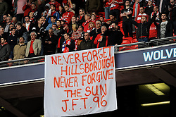 Liverpool fans with a banner remembering the 96 fans, who died at Hillsborough in 1996, during the Budweiser FA Cup semi final match between Liverpool and Everton at Wembley on Saturday 14 April 2012 (Photo by Rob Munro)