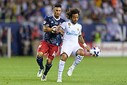 CHICAGO, IL - AUGUST 02: MLS All-Star and Orlando City FC Forward Dom Dwyer (14) battles with Real Madrid defender Marcelo (12) in the second half during a soccer match between the MLS All-Stars and Real Madrid on August 02, 2017, at Soldier Field in Chicago, IL. The game ended in a 1-1 tie with Real Madrid winning on penalty kicks 4-2. (Photo By Daniel Bartel/Icon Sportswire)