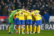 Leeds United get together pre kick off during the EFL Sky Bet Championship match between Bolton Wanderers and Leeds United at the Macron Stadium, Bolton, England on 15 December 2018.