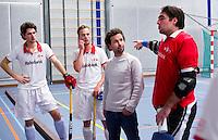 ARNHEM - Rood-Wit coach Wieger Wiese .  ROOD-WIT tijdens de eerste dag van de zaalhockey competitie in de hoofdklasse, seizoen 2013/2014. rechts Laurens Goedegebuure. COPYRIGHT  KOEN SUYK