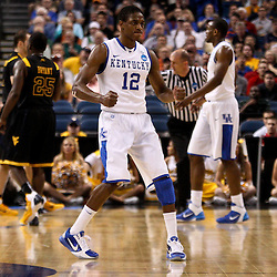 Mar 19, 2011; Tampa, FL, USA; Kentucky Wildcats guard Brandon Knight (12) against the West Virginia Mountaineers during the first half of the third round of the 2011 NCAA men's basketball tournament at the St. Pete Times Forum.  Mandatory Credit: Derick E. Hingle