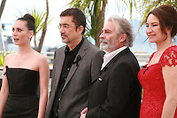 Melisa Sözen, Nuri Bilge Ceylan, Haluk Bilginer and Demet Akbağ at the photocall for the film Winter Sleep (Palme d'Or winner) at the 67th Cannes Film Festival, Friday 16th May 2014, Cannes, France