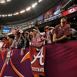 Jan 9, 2012; New Orleans, LA, USA; Alabama Crimson Tide fans celebrate after their team defeated the LSU Tigers 21-0 in the 2012 BCS National Championship game at the Mercedes-Benz Superdome.  Mandatory Credit: Derick E. Hingle-US PRESSWIRE