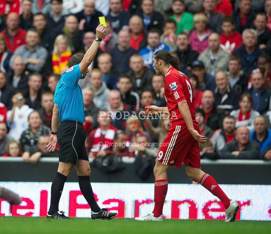 LIVERPOOL, ENGLAND - Saturday, September 24, 2011: Liverpool's Andy Carroll is shown the yellow card by referee Kevin Friend during the Premiership match against Wolverhampton Wanderers at Anfield. (Pic by David Rawcliffe/Propaganda)