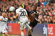 Daniel James (20) of Swansea City gets a high boot in the fave from Yakou Meite (21) of Reading during the EFL Sky Bet Championship match between Swansea City and Reading at the Liberty Stadium, Swansea, Wales on 27 October 2018.