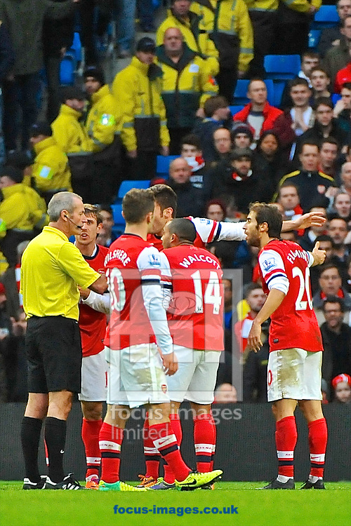 Picture by Ian Wadkins/Focus Images Ltd +44 7877 568959<br /> 14/12/2013<br /> Arsenal players surround the referee to appeal the decision during the Barclays Premier League match at the Etihad Stadium, Manchester.