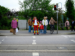GERMANY SCHLESWIG-HOLSTEIN ECKERNFOERDE 21MAY06 - Pedestrians wait at a red pedestrian traffic light awaiting green before they will cross the road.....jre/Photo by Jiri Rezac....© Jiri Rezac 2006