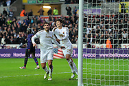 Swansea city's Danny Graham (l) celebrates with Ki Sung-Yueng ® after he scores his sides 2nd goal to make it 2-2.  FA cup with Budweiser, 3rd round match, Swansea city v Arsenal at the Liberty Stadium in Swansea, South Wales on Sunday  6th Jan 2013. pic by Andrew Orchard, Andrew Orchard sports photography,
