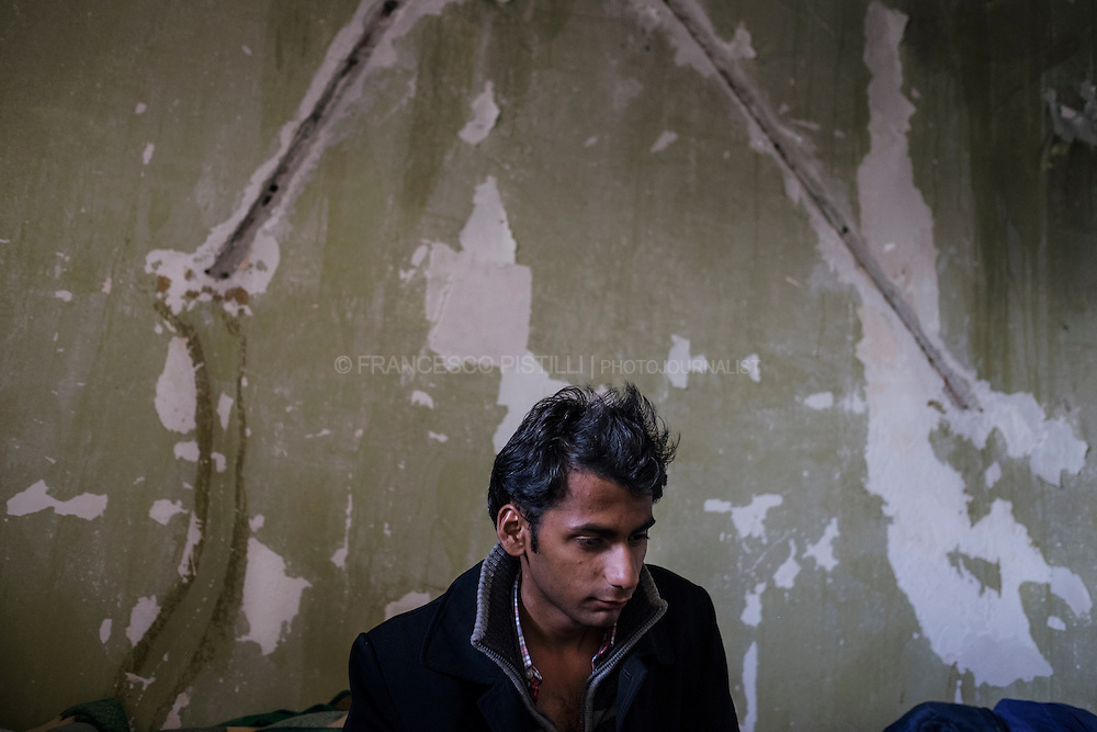 "S. is from Pakistan and he lives in an abandoned building along the highway that runs close to the Greek border with Macedonia. He shares a little room with four to six other ""travel mates"". They have been waiting and surviving here for two months without drinkable water, electricity, windows, doors and bathrooms."