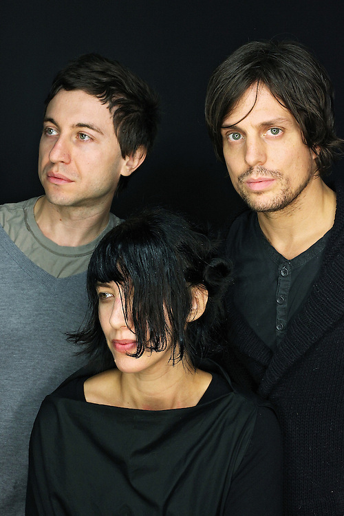 MONTICELLO, NY - SEPTEMBER 12:  (L to R) Eugene Goreshter, Carla Azar and  Greg Edwards of Autolux pose for a portrait at the ATP New York 2009 festival at the Kutsher's Country Club on September 12, 2009 in Monticello, New York.  (Photo by Roger Kisby/Getty Images)