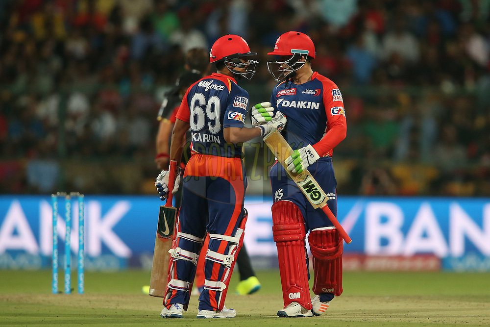 Karun Nair of Delhi Daredevils congratulates Quinton de Kock of Delhi Daredevils for reaching his fifty during match 11 of the Vivo IPL (Indian Premier League) 2016 between the Royal Challengers Bangalore and the Delhi Daredevils held at The M. Chinnaswamy Stadium in Bangalore, India,  on the 17th April 2016<br /> <br /> Photo by Shaun Roy / IPL/ SPORTZPICS