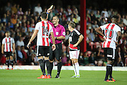 Brentford defender John Egan (14)  is shown a yellow card, booked during the EFL Sky Bet Championship match between Brentford and Nottingham Forest at Griffin Park, London, England on 16 August 2016. Photo by Matthew Redman.