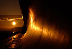© Licensed to London News Pictures. 19/02/16<br /> Redcar, UK. <br /> <br /> The rising sun is reflected in the sea wall at Redcar beach in Cleveland. <br /> <br /> Photo credit : Ian Forsyth/LNP