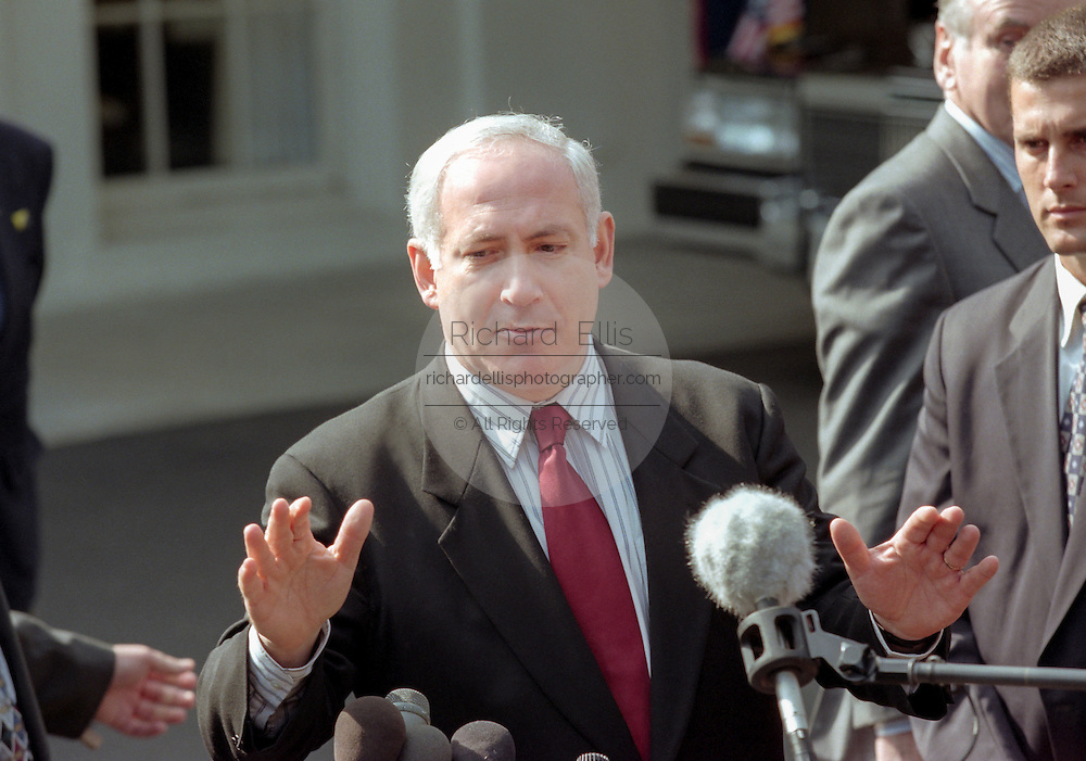 Israeli Prime Minister Benjamin Netanyahu speaks to reporters outside of the White House after meeting with President Bill Clinton and Palestinian leader Yasser Arafat October 15, 1998 in Washington, DC. Netanyahu and Arafat are meeting in the US to try and revive the Middle East peace accord.