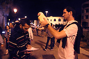 """Israel, Jerusalem, Kaparot (""""atonements"""") is a disputed ancient Jewish ritual to save oneself from a harsh Heavenly decree by it being effected on another object. Vegetables, fish, money, and most commonly a Chicken have been used throughout the centuries, The service is performed by grasping the object and moving it around one's head three times, symbolically transferring one's sins to the object."""