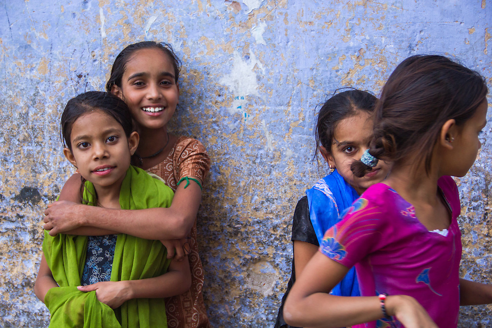 Girls in colorful saris having fun on the streets of Jaipur, Rajasthan, India.