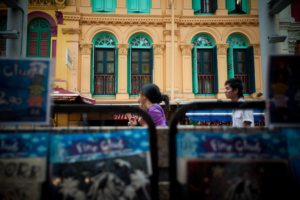 Pedestrians walk through the heart of Singapore's Chinatown.