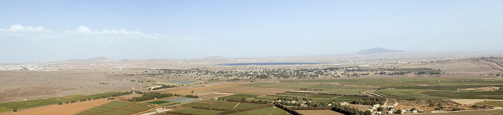Israel, Golan Heights, Panoramic view of the Valley of Tears (Emek Habacha) on the Syrian border site of a fierce battle in the Yom Kippur war of 1973 As seen from Mount Bental. New Quneitra in the background