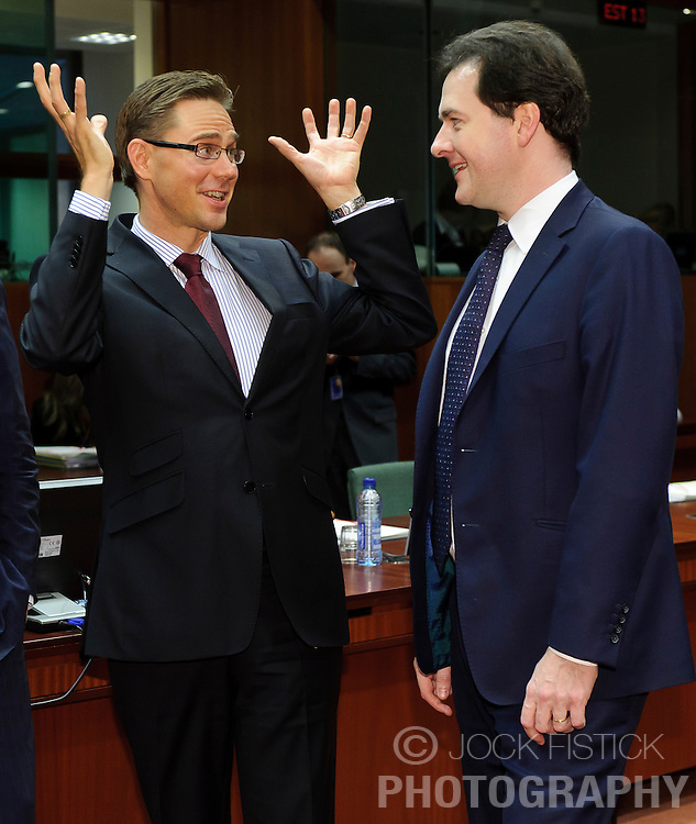 Jyrki Katainen, Finland's finance minister, left, shares a laugh with George Osborne, the UK's chancellor of the exchequer, during a meeting of EU finance ministers, at the European Council headquarters, in Brussels, Tuesday, Dec. 7, 2010. (Photo © Jock Fistick).