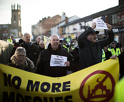 "© Licensed to London News Pictures . 26/11/2016 . Bolton , UK . Anti-mosque demonstrators march from Bolton station to Victoria Square . Approximately 100 people attend a demonstration against the construction of mosques in Bolton , under the banner "" No More Mosques "" , organised by a coalition of far-right organisations and approximately 150 anti fascists opposing the demonstration , in Victoria Square in Bolton Town Centre . Photo credit : Joel Goodman/LNP"