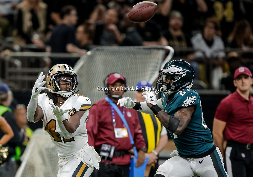 Nov 18, 2018; New Orleans, LA, USA; New Orleans Saints running back Alvin Kamara (41) catches a touchdown over Philadelphia Eagles safety Malcolm Jenkins (27) during the second half at the Mercedes-Benz Superdome. Mandatory Credit: Derick E. Hingle-USA TODAY Sports