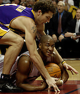 PHOTO BY DAVID RICHARD.Cavaliers' guard Eric Snow tries to call time out while be guarded be Luke Walton of the Lakers March 19 in Cleveland.