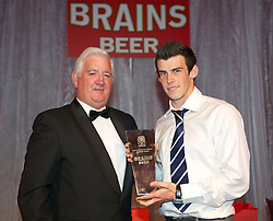 CARDIFF, WALES - Tuesday, October 4, 2011: Wales' Gareth Bale receives his Player of the Year Award from President Phil Pritchard at the FAW Footballer of the Year Awards 2011 held at the Wales National Museum. (Pic by David Rawcliffe/Propaganda)