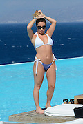 *****EXCLUSIVE*****<br /> Mykonos island, Greece, 12 September 2016<br /> Glamour model Lauryn Goodman pictured in a blue and white bikini pool side in Greece, as she continues her holiday in Mykonos<br /> ©Exclusivepix Media