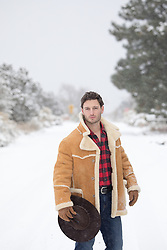 hot cowboy on a snow covered street