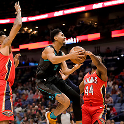 Apr 3, 2019; New Orleans, LA, USA;  Charlotte Hornets guard Jeremy Lamb (3) shoots over New Orleans Pelicans forward Christian Wood (35) and forward Solomon Hill (44) during the first quarter at the Smoothie King Center. Mandatory Credit: Derick E. Hingle-USA TODAY Sports