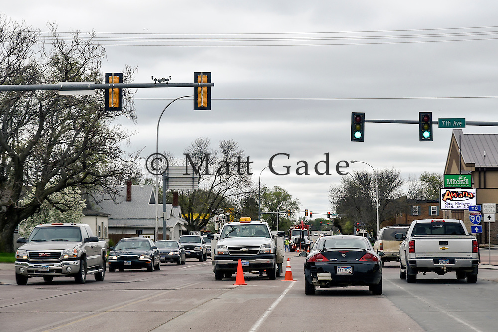 Traffic makes its way down Sanborn St. on Monday afternoon as city workers work on the utilities underneath the street between 5th Ave. and 7th Ave. in Mitchell. (Matt Gade/Republic)