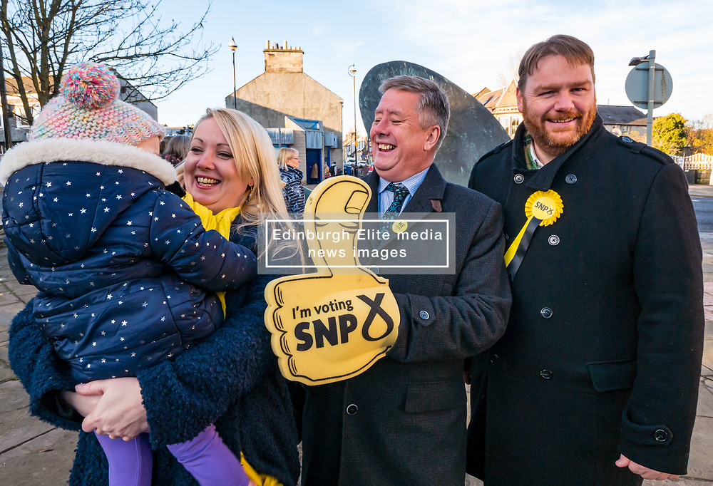 Pictured; Kelly and Isla (nearly 2years), wife & daughter of Owen Thompson, Keith Brown, SNP Depute Leader and Owen Thompson<br /> <br /> Loanhead, Midlothian, Scotland, United Kingdom, 18 November 2019. General Election campaigning:  SNP Depute Leader Keith Brown MSP joins Owen Thomson, SNP candidate for Midlothian, on the campaign trail at Fountain Green, Loanhead.<br /> <br /> Sally Anderson | EdinburghElitemedia.co.uk