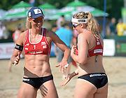STARE JABLONKI POLAND - July 3: Barbara Hansel /1/ and Katharina Schutzenhofer of Austria in action during Day 3 of the FIVB Beach Volleyball World Championships on July 3, 2013 in Stare Jablonki Poland.  (Photo by Piotr Hawalej)
