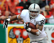 Running back Justin Fargas (25) of the Oakland Raiders rushes up field in the second quarter against the Kansas City Chiefs at Arrowhead Stadium in Kansas City, Missouri on September 14, 2008...