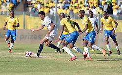 02/09/2018. Matthew Rusike of Cape Town City FC gets away with the ball from Mamelodi Sundowns players during their MTN8 match at Lucas Moripe Stadium in Atteridgeville.<br /> Picture: Oupa Mokoena/African News Agency (ANA)