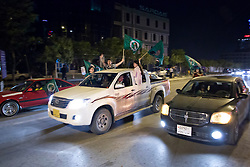 © Licensed to London News Pictures. 27/04/2014. Sulaimaniya, Iraq. Supporters of the Patriotic Union of Kurdistan (PUK) political party fly flags from their car during celebrations in the lead up to the 2014 Iraqi parliamentary elections in Sulaimaniya, Iraqi-Kurdistan.<br /> <br /> Although banned in other parts of Iraqi-Kurdistan, the days leading up to an election in Sulaimaniya sees political supporters of all the three main parties parading up and down the main street of the city, waving flags, honking horns, letting off fireworks and firing pistols and rifles into the air.<br /> <br /> The period leading up to the elections, the fourth held since the 2003 coalition forces invasion, has already seen six polling stations in central Iraq hit by suicide bombers causing at least 27 deaths. Photo credit: Matt Cetti-Roberts/LNP