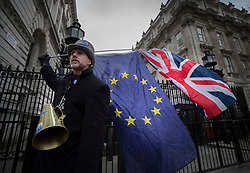 © Licensed to London News Pictures. 08/01/2018. London, UK. A Union flag and a European Union flag are held aloft by a protestor outside Downing Street. Photo credit: Peter Macdiarmid/LNP