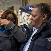 WASHINGTON,DC - MAR18: Lashae Hunter, a senior at Cesar Chavez Public Charter School for Public Policy, wipes tears of joy from her eyes, with her mother Warrenrenia Hunter, after she was surprised at school with a hand-delivered acceptance letter and full scholarship to attend George Washington University, March 18, 2015, through the Stephen Joel Trachtenberg Scholarship program. (Photo by Evelyn Hockstein/For The Washington Post)