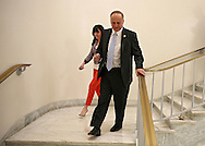 Representative Steve King (R-IA) talks with Brittany Lesser, Communications Director, as they walk down a stairway in the Rayburn House Office Building in Washington, DC on Tuesday, April 16, 2013.