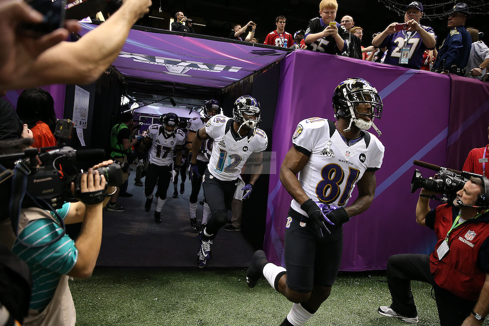 Members of the Baltimore Ravens enter the field against the San Francisco 49ers during the NFL Super Bowl XLVII football game in New Orleans on Feb. 3, 2013. The Ravens won the game, 34-31.  (Photo by Jed Jacobsohn)
