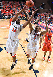 Virginia forward Jamil Tucker (12) grabs a rebound against VT.  The Virginia Cavaliers defeated the Virginia Tech Hokies 75-61 at the John Paul Jones Arena on the Grounds of the University of Virginia in Charlottesville, VA on February 18, 2009.
