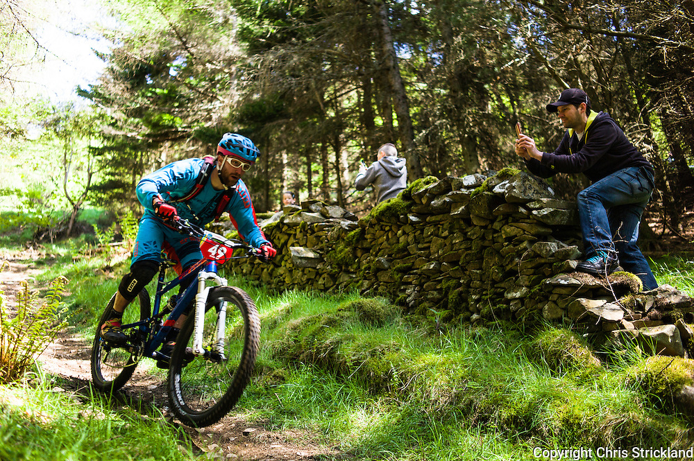Innerleithen, Tweed Valley, Scotland, UK. 30th May 2015. Spectators photograph the action on mobile phone cameras at The Enduro World Series Round 3 taking place on the iconic 7Stanes trails during Tweedlove Festival. Mountain bikers come up against eight stages across two days, with an intense 2,695 metres of climbing over 93km. As well as the physicality of the liaisons, the stages themselves are technical, catching many off guard.